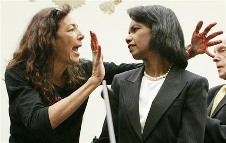 Desiree of Code Pink confronts Rice with bloody hands