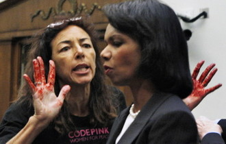Desiree of Code Pink confronts Rice with bloody hands, pic 2
