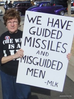 Me, holding a sign in the 2011 King Holiday Parade in Oklahoma City.